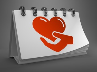Desktop Calendar with Icon of Heart in the Hand.