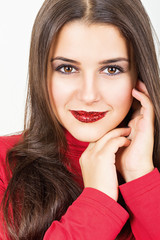 Cute young woman with red sequins lipstick