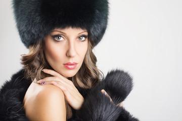 Glamorous young woman wearing black fur