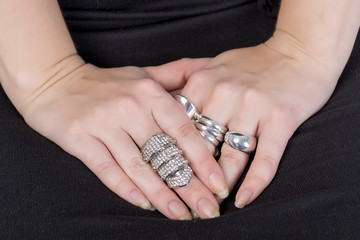 Woman wearing multiple rings
