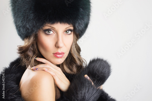 Glamorous young woman wearing black fur