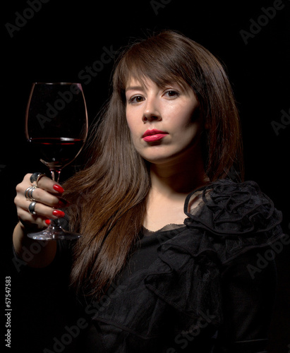Young woman with red wine from a glass