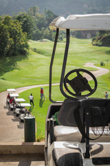 Golf club cars at golf field