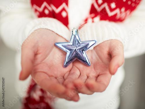 Silver star on palms