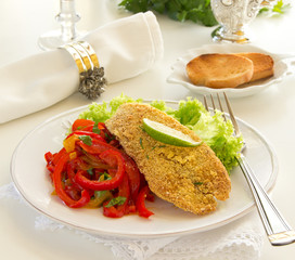 Fried cod fillet with sweet and sour peppers.