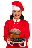 Chef woman holding sponge cake with grapes
