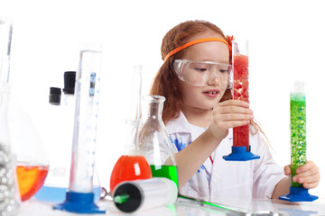 Image of surprised little experimenter in studio