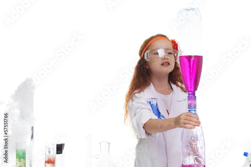 Adorable girl watching reaction of reagents