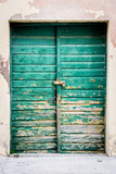 Old rustic wooden doors painted in green