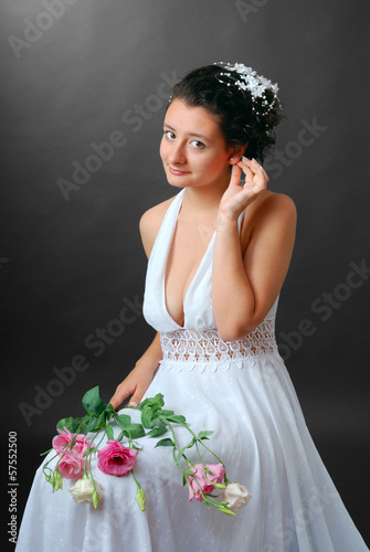 Happy bride readjusting an earring