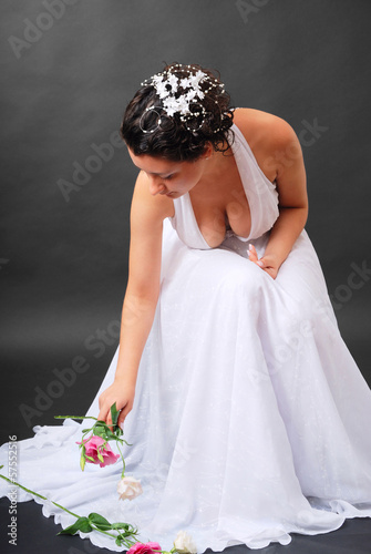 Happy bride picking up flowers.