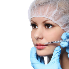 Botox. Cosmetic injection in beautiful female face isolated