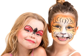 Face painting, tiger and ladybug