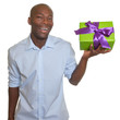 Laughing african man presents a gift