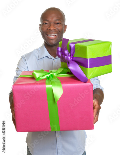 Laughing african man with two gifts for christmas