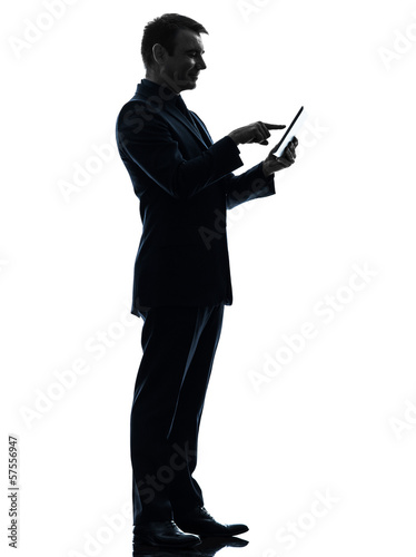 business man touchscreen digital tablet  silhouette
