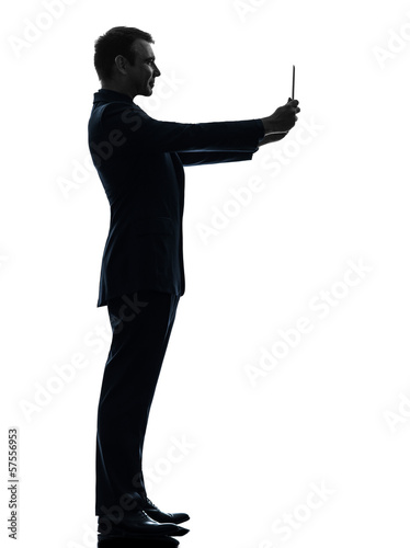 business man  photographing digital tablet  silhouette