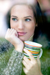 Portrait of a beautiful young woman with a cup of tea coffee loo