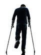 injured man walking with crutches silhouette rear view