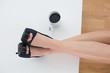 Businesswoman in high heels relaxing feet up in office desk