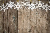 Snowflakes border on wood