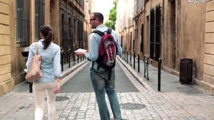 Lost arguing couple looking for direction using tablet