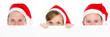 weihnachtsmänner mit werbeschild