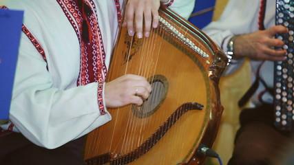 Ukrainian folk artist plays the bandura