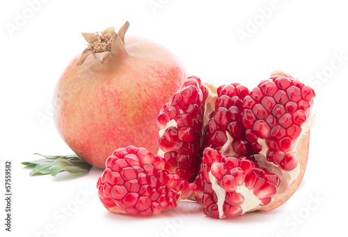 Ripe pomegranates with leaves isolated on white