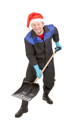 Worker in santa hat with shovel.