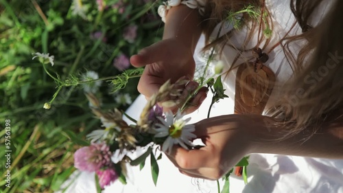 girl makes a wreath of wildflowers