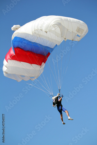 parachutist flying on blue sky