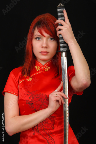 woman with samurai sword on black background