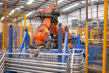 Robotic machinery lifting steel gates in factory