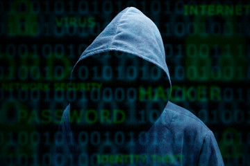 Hooded silhouette of a hacker