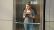 Young business woman in an elevator with a Tablet PC