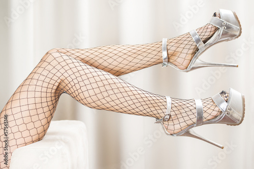 canvas print picture sexy legs in fishnet stockings and extreme platform sh