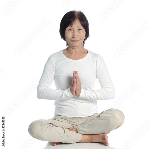 Asian senior woman meditating for yoga