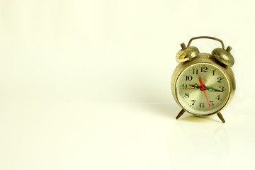 Old alarm clock isolated on white background