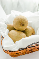 Kiwi fruits on the Empty yellow wicker tray