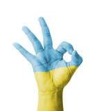 Hand making Ok sign, Ukraine flag painted