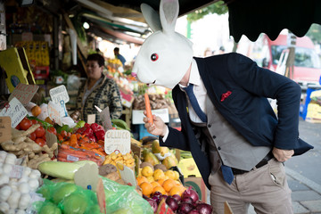 rabbit mask man with carrot