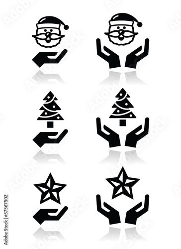 Hands with christmas icons - santa claus, tree, star