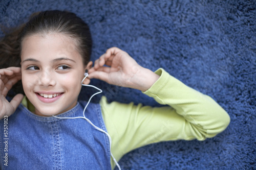 Girl listening to earphones