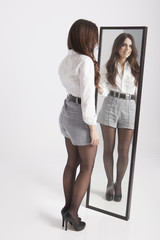 real young woman looking in a mirror