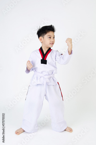 Taekwondo action  by a asian cute boy