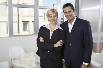 Businesswoman and businessman (portrait)
