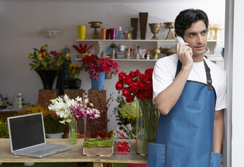 Male florist on phone