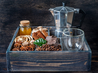 Coffee grains, spices, honey and chocolate in vintage box