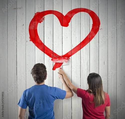 Couple drawing a heart